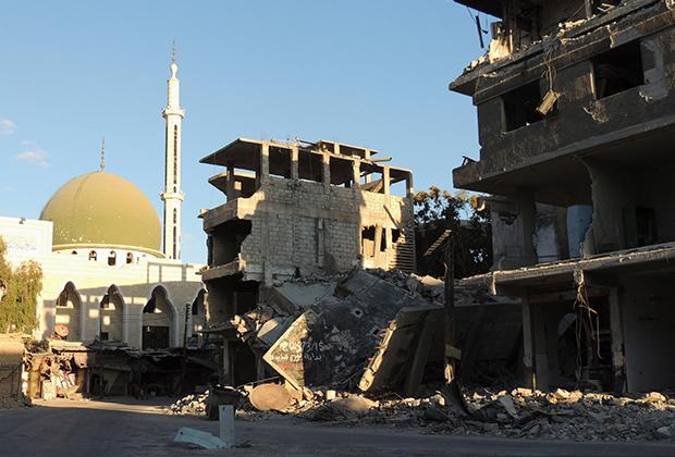 Руины домов в сирийской Гуте, где в августе 2013 года было использовано химическое оружие