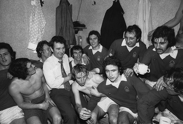 Nottingham Forest manager Brian Clough (1935 - 2004, centre, left) with his team in the dressing room after their 1-0 victory over Tottenham Hotspur in an FA Cup Third Round Replay at White Hart Lane, London, 8th January 1975. This was Clough's first game in charge as Nottingham Forest manager. (Photo by Michael Fresco/Evening Standard/Hulton Archive/Getty Images)