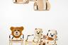 Фирменный мишка бренда Moschino, придуманный его креативным директором Джереми Скоттом, превратился в забавный ночник из пластика с надписью This is not a Moschino Toy («Это не игрушка Moschino») на животе. Портреты смешного мишки украсили и стулья Louis Ghost.
