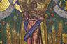 Мозаичное панно «Мир во всем мире» художника Павла Корина — визитная карточка другой столичной станции метро — «Новослободской». Изображение расположено в торце зала. Вокруг — витражи, выполненные также по эскизам Корина. Главное панно изображает женщину с ребенком, тянущим руки к солнцу. Интересно, что изначально вместо солнца в верхней части мозаики размещался портрет Сталина. В хрущевские времена ее вообще убрали со станции, а потом вернули обратно — но уже без диктатора.
