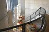 Прихотливое внутреннее устройство павильона Тадао Андо позволяет выделить несколько автономных и практически изолированных друг от друга зон для встреч и мероприятий. Бетон стен контрастирует с теплыми оттенками натурального дерева — напольными покрытиями и стеновыми панелями. Стеклянные стены обеспечивают естественное освещение. Помещения обставлены мебелью Vitra, в том числе стульями HAL Ply по дизайну Джаспера Моррисона.