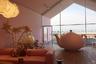 Верхний этаж VitraHaus занимает сказочный интерьер, где мебель Vitra соседствует с гигантскими чайниками и фантастическими цветами. Обстановка навеяна атмосферой сказки Льюиса Кэрролла «Алиса в стране Чудес». Открывающиеся за огромными окнами холмистые пейзажи дополняют впечатление.