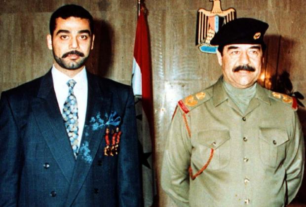 Саддам Хусейн (справа) и его сын Удей