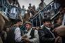 Пономарев был в  Афганистане несколько раз. Эта серия снята весной 2013 года для The New York Times.   <br> <br>  Рынок в Кабуле, где местные менялы торгуют деньгами. Здесь можно обменять пакистанскую, турецкую, узбекскую валюту и доллары. Курс прикидывают интуитивно, цены назначают за пачки купюр. Местная валюта девальвирована, поэтому на таких рынках можно встретить торговцев, восседающих на огромных кучах денег.
