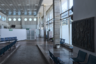 Современный комплекс построили далеко за городом, рядом с федеральной трассой. Аэровокзал возводили ударными темпами и открыли в самом конце 2017 года. Британское бюро Twelve Architects ответственно за общую форму крыши — набегающую волну, и интерьерные решения залов регистрации и вылета. Nefa и VOX из Москвы — за VIP-залы, Wowhaus — за благоустройство.