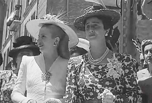 Расстроенная жена Франко рядом с Эвой Перон в ее знаменитой шляпке