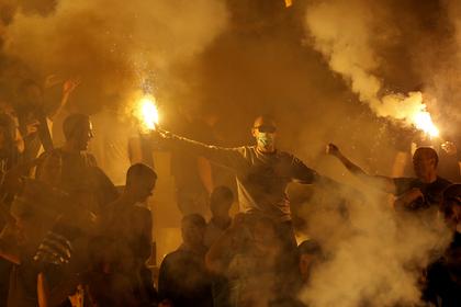 Фанаты подожгли автобус с футболистами во время празднования чемпионства