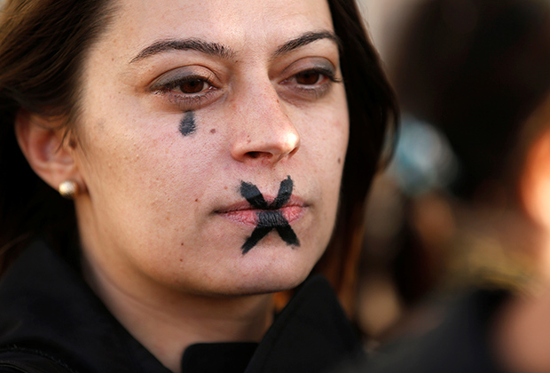 A woman with a tear and a cross painted on her face demonstrates during a gathering against gender-based and sexual violence in Marseille, France, October 29, 2017. REUTERS/Jean-Paul Pelissier