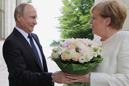 Объяснен смысл «оскорбительного букета» от Путина Меркель