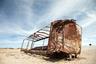 Если тяжелые локомотивы так и стоят на рельсах, то легкие вагоны в большинстве своем сброшены с путей и растащены до каркасов.