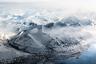 При перелете из Тромсе в Лонгйир, крупнейший населенный пункт Шпицбергена, открывается вид на заснеженные вершины Свальбарда (второе название Шпицбергена). Больше половины его территории покрыто ледниками, в которых живут белые медведи: четыре тысячи зверей на три тысячи жителей. Гиды всегда носят с собой оружие, чтобы в случае нападения медведя защитить туристов.