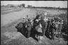 Возвратившиеся жители освобожденной деревни Молодино около могил бойцов, погибших в бою за их деревню. Район Ржева.