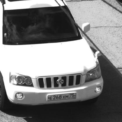 Фото из материалов уголовного дела: автомобиль Красноярова, зафиксированный на улице города в день убийства (для идентификации).