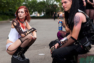 LEIPZIG, GERMANY - JUNE 11:  Gothic rock music enthusiasts make a break during the annual Wave Gotik music festival on June 11, 2011 in Leipzig, Germany. The festival began in the 1990s and has since grown into one of the biggest gatherings of Goth scene followers in Europe with around 20,000 participants. Many of those attending wear elaborate outfits and make-up for which they require hours of painstaking preparation and that also show a departure from the traditional black of the Goth scene. Punk remains a strong influence in todays Goth style as witnessed in Leipzig, but newer trends, with names like Cybergoth and Steampunk, have emerged that blend bold colors, Victorian fashion elegance and 19th and 20th century factory accessories into a look reminiscent of a mutated Venetian carnival. The five-day festival includes performances by around 200 bands.  (Photo by Carsten Koall/Getty Images)