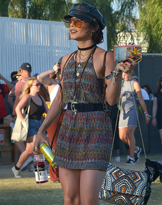 Indio, CA  - Coachella queen, Vanessa Hudgens, is spotted as she looks at her map to navigate the Polo Fields. She keeps it Boho while enjoying weekend 2.