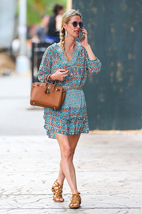 New York, NY  - *EXCLUSIVE*  - Nicky Hilton channels her inner hippie while out in the East Village. The socialite was wearing a more casual ensemble of cute print minidress and round-framed sunglasses while taking a phone call.