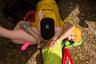 Участник турнира отдыхает, подложив под голову талисман команды — надувную куклу. Ее гермафродитная природа осталась загадкой для других игроков и болельщиков.