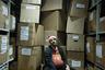 «Я часто бываю на складах, и каждый раз ряды коробок и паллет напоминают мне Кафку. Как Новый год может выглядеть для работника склада — ничего не меняется, коробки, стеллажи, погрузчики, и новогодняя шапочка».