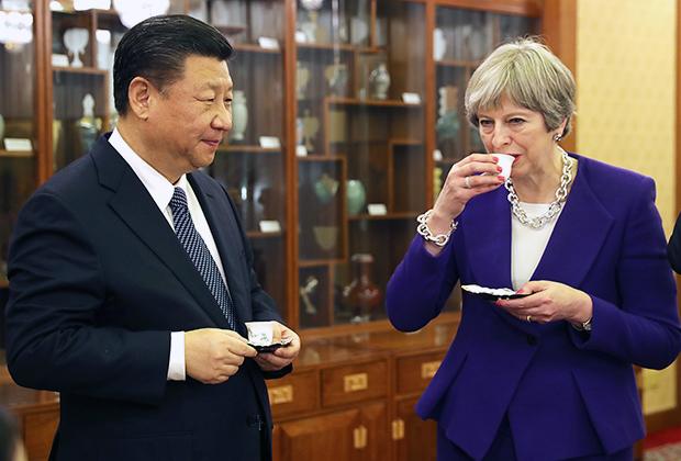 Председатель КНР Си Цзиньпин и премьер-министр Великобритании Тереза Мэй во время встречи в феврале 2018-го