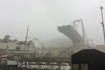 Автомобильный мост рухнул в итальянской Генуе и убил десятки человек