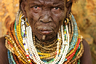 Ньянгатом, также известны как донииро и уничижительно, как буме, — это один из нилотских народов. Проживают на границе юго-западной Эфиопии и юго-восточного Южного Судана и в Треугольнике Илеми, по обе стороны границы. Нилооты — группа родственных народов Африки. Вплоть до XX века территория проживания нилотов постоянно страдала от набегов работорговцев, а  конце XIX века оказалась разделена между различными колониальными владениями. Нилоты до сих пор в значительной степени придерживаются родоплеменных отношений. Основные занятия — разведение крупного рогатого скота, земледелие, рыболовство и охота. У племени часто происходят кровавые конфликты с соседями, особенно с племенами туркана, дассанеш и сури.