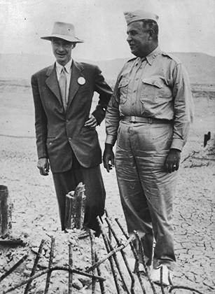 Nuclear physicist Julius Robert Oppenheimer (1904 - 1967), left, with Major General Leslie Groves, by the remains of the tower from which an atom test bomb was ignited, at Los Alamos, California