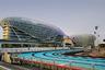 Именно на острове Яс расположен и гоночный трек Marina Yas Circuit, каждый год принимающий Гран-при Абу-Даби «Формулы-1». Что особенно интересно, проехать по той же трассе, на которой рассекают Феттель и Хаккинен, может и каждый из посетителей — и если открытым формульным болидом с пассажиром будет управлять профессиональный пилот (скорости в 250 километров в час и фирменные резкие торможения в поворотах обеспечены), то вести по трассе гоночный кузовной Aston Martin или Jaguar дают и самим гостям.