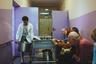 Санитар Геннадий несет кастрюлю с едой во время обеда в психоневрологическом интернате для престарелых и инвалидов № 3.