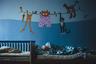 Пациент психоневрологического интерната № 3 спит в своей комнате. Все живущие здесь, за малым исключением, — дети, от которых родители отказались при рождении. Большинство из них остаются в этих стенах всю жизнь, вплоть до самой смерти.