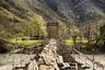 Шаткий деревянный мост над рекой Бзыбь раскачивается не только ветром, но и топотом туристов, которые заезжают сюда в поисках острых ощущений по дороге на озеро Рица и Гегский водопад.