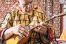 Николай Геннадиевич Яковлев, коренной алеут с острова Медный (в настоящее время остров необитаем), в национальной одежде. Яковлев увлекается игрой на народных инструментах, в том числе на балалайке.
