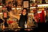 «Во время войны, когда падали бомбы, целые дни могли быть без клиентов. Но мы никогда не переставали работать», — рассказывает 24-летняя бармен по имени Дана.