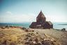 Севан — самое большое горное озеро в мире после озера Титикака. Путь от Еревана до Севана занимает минут сорок, и не поехать туда будучи в Армении летом — все равно что побывать в этой стране и не поесть долмы. В северо-западной части озера, на узком скалистом полуострове расположен памятник армянского раннесредневекового зодчества — монастырь Севанаванк. Сегодня от монастыря, построенного в IX веке, остались лишь два храма — Сурб Аракелоц и Сурб Аствацацин, стоящие среди множества древних хачкаров (каменных крестов). Здания церквей построены из черного туфа, отсюда происходит и название монастыря — «Черный монастырь».