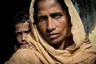 Еще один фотопроект о судьбе народа рохинджа в Мьянме. Работа датского фотохудожника Асгера Ладефоджеда (Asger Ladefoged), посвященная проблеме нетерпимости в современном мире, признана лучшей в категории «Портрет».  <br> <br> На снимке — 40-летняя Рахима Катун. Женщина бежала со своим мужем и тремя детьми в Бангладеш в начале сентября под угрозой смерти. «Солдаты из армии Мьянмы убили моего дядю. Он стоял прямо передо мной, я видела это. Если мы вернемся туда, они убьют и нас», — сказала она. <br> <br> Этнические чистки в Мьянме нацелены на вытеснение народа рохинджа. Правительство страны продолжает настаивать, что таким образом силовики осуществляют борьбу с терроризмом.