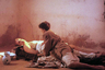 Драма «Под покровом небес», снятая по одноименному роману Пола Боулза — о супружеской чете из США, которая путешествует по Северной Африке. Поездка, призванная возродить отношения пары, превращается в кошмар наяву. В фильме 1990 года снялись Дебра Уингер и Джон Малкович.