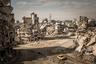 Снимок фотожурналиста Кристиана Вернера стал символом разрушительных бомбежек в Сирии. Корреспондент отправился в Сирию по заданию издания Der Spiegel. Он много раз бывал в горячих точках, но масштаб разрушений в сирийском городе Хомс его поразил. В разбомбленном городе воцарилась мертвая тишина, был слышен только ветер и щебетание ласточек. Руины были повсюду, но показать их грандиозность с земли возможности не было, поэтому фотограф на свой страх и риск взобрался на разбомбленный дом, внутри которого оставались самодельные взрывные устройства, чтобы запечатлеть ужас с высоты.