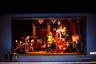 """«Это опера сама по себе очень интересна с точки зрения участия в ней большого количества певцов. Она требует колоссального состава — 16 фантастических виртуозных солистов, владеющих колоратурами Россини. Эта опера может считаться прикладной, ведь она была сочинена по заказу к коронации Карла Х и, тем не менее, Россини написал совершенно гениальную музыку. Мне самому она очень импонирует, и после успешного концертного исполнения, которое было так тепло принято публикой, мне казалось, что сценическая версия """"Путешествия в Реймс"""" на нашей сцене должна иметь успех», — рассказал музыкальный руководитель, главный дирижер Большого театра и дирижер-постановщик оперы Туган Сохиев."""