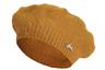 Вновь вернувшийся в моду в последние годы аксессуар в парижском стиле очень удобно дарить: в отличие от шляп, размер берета универсален. Модель теплого охристого оттенка украшает забавный посеребренный зайчик — подарок для романтичной Зайки.
