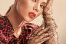 На родине Грэй знают и любят: она ведет телепередачи, работает моделью и даже записала музыкальный альбом.