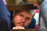 """16 июля Пресненский районный суд Москвы <a href=""""https://lenta.ru/news/2018/07/16/kuzya/"""" target=""""_blank"""">вынес приговор</a> Андрею Попову, более известному как «бог Кузя». Его признали виновным в мошенничестве, создании деструктивного религиозного сообщества и назначили наказание в виде пяти лет колонии общего режима. <br> <br> Суд установил, что в 90-е годы Попов основал псевдоправославную секту, действовавшую по принципу финансовой пирамиды. Попов лично отбирал членов организации и участвовал в обрядах, связанных с физическим и психическим насилием над сектантами. За малейшее неповиновение адептов наказывали ударами плеткой или кожаным ремнем по рукам.  <br> <br> После задержания <a href=""""https://lenta.ru/articles/2017/10/12/kuzya/"""" target=""""_blank"""">Попова</a> в сентябре 2015 года в семи квартирах, имевших отношение к секте, были проведены обыски. Сотрудники полиции изъяли из них более 43 миллионов рублей и свыше 100 тысяч долларов. Кроме того, были обнаружены специфическая литература, экзотические животные, компьютеры и тетради с бухгалтерскими записями."""