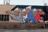 """Никита Nomerz —  уличный художник из Нижнего Новгорода. Его работы <a href=""""https://crossarea.ru/street-art/artists/nikita-nomerz/"""" target=""""_blank"""">можно увидеть</a> на фасадах заброшенных домов и объектах городской инфраструктуры в Екатеринбурге, Новосибирске, Перми, Иркутске, Красноярске, Москве. Nomerz несколько лет путешествовал по стране и в 2018 году <a href=""""https://tass.ru/kultura/5533630"""" target=""""_blank"""">выпустил</a> фильм «В открытую» — первую ленту о граффити и стрит-арте в России.  <br> <br> Является одним из организаторов фестиваля уличного искусства «Место», основная задача которого — переосмысление городской среды и создание новых уличных арт-объектов, а также мастер-классы и лекции от знаковых представителей отечественного стрит-арта, показы тематических документальных фильмов и экскурсии. В 2018 году в рамках фестиваля Nomerz организовал площадку в Москве: бетонный забор на Преображенском Валу площадью почти 500 квадратных метров стал холстом для 20 уникальных уличных работ."""