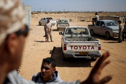 В Ливии откопали тела десятков жертв ИГ
