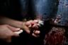 Забой кур в семейной бойне в мексиканском городе Исукар-де-Матаморос, штат Пуэбло. Перед смертью птиц не оглушают, хотя закон требует это делать.