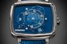Новая модель оснащена автоматическим калибром HTL 205-1, заключенным в четырехугольный титановый корпус. Необычность часов — в бесстрелочной индикации времени: часы и минуты демонстрируются с помощью вращающихся с разной скоростью дисков на циферблате.