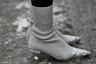Кроссовки-носки в моде уже не первый сезон, но настоящие модницы носят серебристые носки-туфли со стразами на каблучке kitten heels.