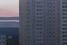 На этой картинке художник изобразил вид из окна своей квартиры. По его мнению, именно так демон панельных многоэтажек присматривает за своим районом, чтобы все было четко и ровно.