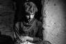 Тему беженцев продолжает иранский фотограф Энайат Асади, который начиная с 2011 года пристально следит за Афганистаном. Внимание фотографа сосредоточено на общественных проблемах, нарушениях прав человека, бедности, несправедливости и социальной дискриминации. В 2017 году начал исследовать тему миграции.  <br> <br> Подавляющее большинство беженцев направляется из Афганистана в Иран, чтобы оттуда проникнуть в Турцию и Грецию. По оценкам, в настоящее время в Иране находятся 1,5 миллиона афганцев без документов. Фотограф отмечает, что несмотря на желание мигрантов обрести благополучие, часть из них попадут в рабство, а некоторые по прибытии в Европу вольются в ряды секс-работников. <br> <br> На фото один беженец утешает своего измотанного собрата. Номинант в категории «Современные проблемы».
