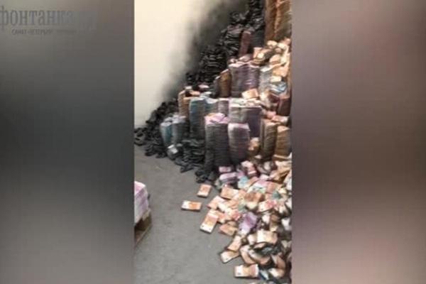 Обгоревшие тонны денег настоличном складе связали сделом Арашукова