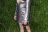 Один из самых растиражированных луков Меган-до-Гарри — ультракороткое платье с глубоким вырезом из металлизированной ткани от бренда Misha Nonoo. Его часто используют, чтобы продемонстрировать разительность перемены стиля актрисы при превращении ее в королевскую невестку.