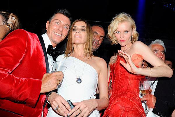 PHOTO: SIPA PRESS/EAST NEWS (L-R)Stefano Gabbana, Carine Roitfeld (Vogue France), Christian Audigier and Eva Herzigova at the 51th birthday party of  Christian Audigie at the VIP Room in Cannes. Cannes, FRANCE -21/05/2009/0905221610